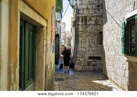 VODICE, CROATIA - SEPTEMBER 6, 2016: This is one of the alleys of the old historic part of the small Croatian seaside town.