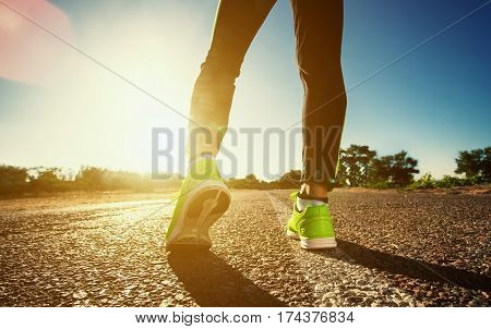 Young Athlete In Sneakers Makes Summer Morning Workout And Exercises. Running On The Move Close-up O