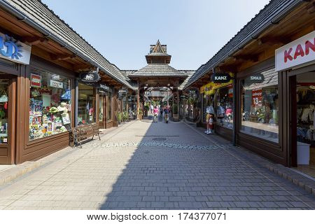 ZAKOPANE POLAND - SEPTEMBER 13 2016: The Fashion Street is in the downtown. It is a shopping mall with many boutiques which are arranged along the alley