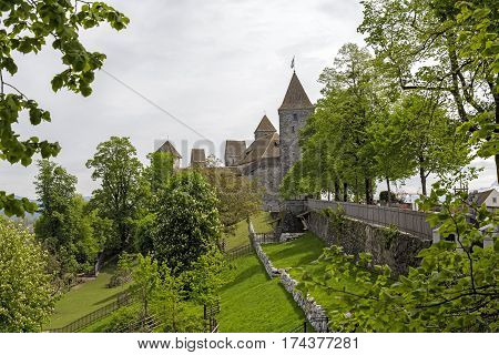 RAPPERSWIL SWITZERLAND - MAY 10 2016: The Castle during cloudy day. It was built in the early 13th century. The castle became the seat of the Polish National Museum since 1870