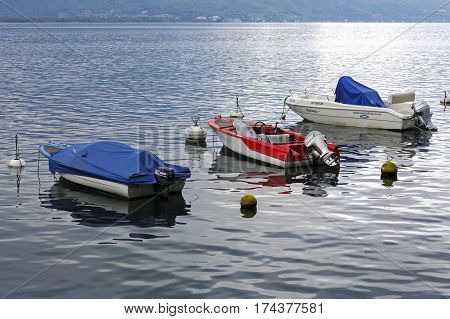 MONTREUX SWITZERLAND - MAY 26 2013: Three boats moored in the waters of Lake Geneva. All of them are equipped with outboard motors.