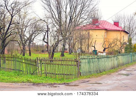 Rural landscape in village Ust Slav at spring cloudy day on the outskirts of St. Petersburg Russia.