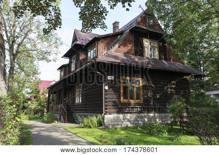 ZAKOPANE POLAND - SEPTEMBER 23 2016: Wooden building in the regional style it is a villa called Hanka which was built in 1911 and is listed in the municipal register of architectural monuments