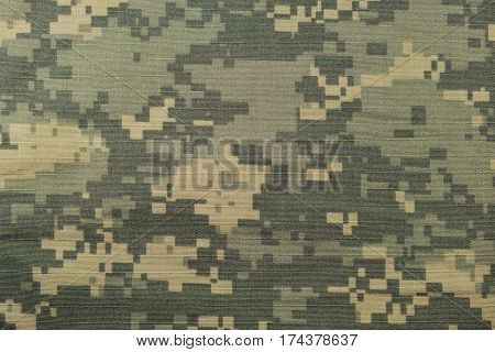Universal camouflage pattern army combat uniform digital camo USA military ACU macro closeup detailed large rip-stop fabric texture background crumpled wrinkled foliage green yellow desert sand tan urban gray