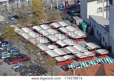 LJUBLJANA SLOVENIA - OCTOBER 12: Farmers Market Aerial in Ljubljana on OCTOBER 12 2014. Central Outdoor Market Stalls in Ljubljana Slovenia.