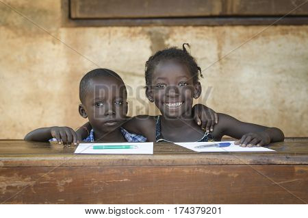 Two african children smiling and studying in school in Bamako Mali.
