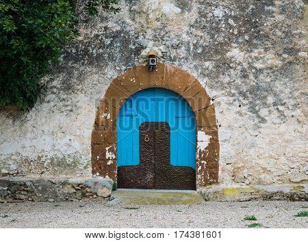 Blue wooden door in the old Spanish rural house