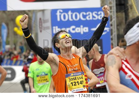 BARCELONA, SPAIN - FEB, 12: Unknown runner in the goal celebrating his position after finish his Barcelona Half Marathon in Barcelona on February 12, 2017 in Barcelona Spain