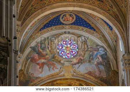 Italy Lucca - September 18 2016: the view of fresco and stained glass window on the interior of Lucca Cathedral. Cattedrale di San Martino on September 18 2016 in Lucca Tuscany Italy.