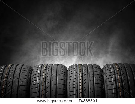 Car tires on a dark background. Summer car tires.