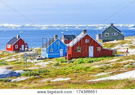 The colorful houses of Rodebay, Greenland. This settlement is located on a small peninsula jutting off the mainland into eastern Disko Bay, 22.5 km north of Ilulissat. It had 46 inhabitants in 2010