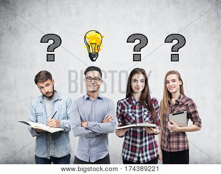 Young Business Team, Questions And Bulb