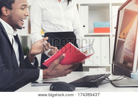 Side View Of African Man And His Coworker