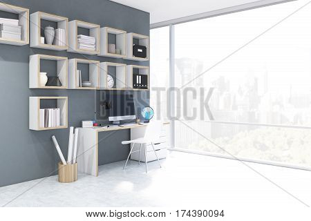 Side view of a desk with computer in a home office with square bookshelves on a gray wall. White chair is standing near the desk. 3d rendering. Mock up