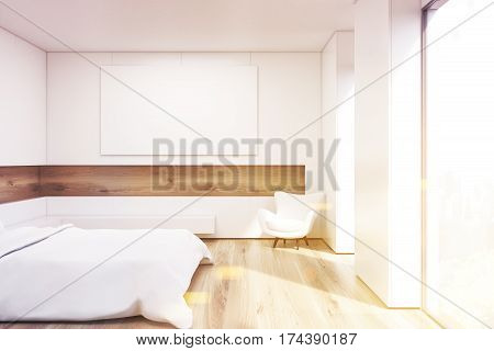 Side view of bedroom with a double bed with white covers in a room with wooden walls and floor. A horizontal picture is hanging on a white wall. 3d rendering. Mock up. Toned image