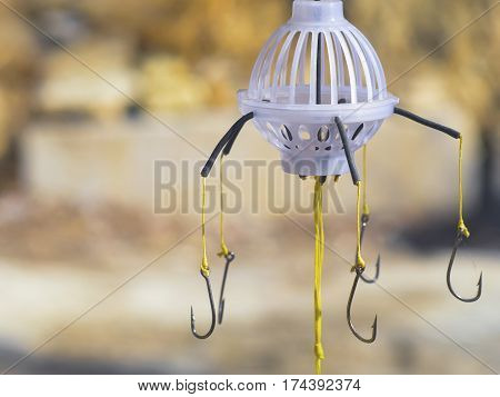 the fishing hooks on a fishing line with trough