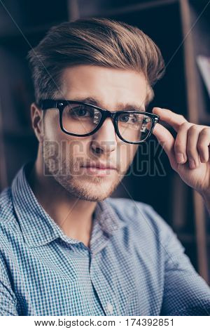 A  Portrait Of Handsome Confident Guy In Checkered Shirt Touching His Glasses