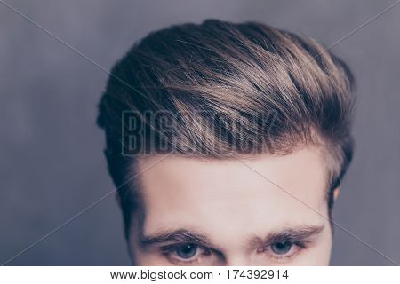 Close Up Photo Of A Young Man's Hair On Gray Background