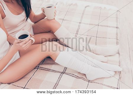 Close Up Of Two Sexy Young Women Holding Cups Of Coffee In Hands