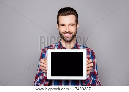 A Young Cheerful Man In Checkered Shirt Isolated On Gray Background Demonstrating Black Screen Of Hi