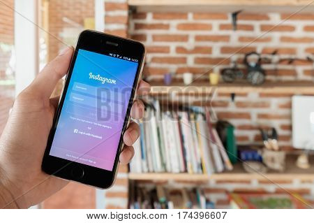 CHIANG MAI, THAILAND - FEB 19, 2017: A man holds Apple iPhone with Instagram application on the screen. Instagram is a photo-sharing app for smartphones.