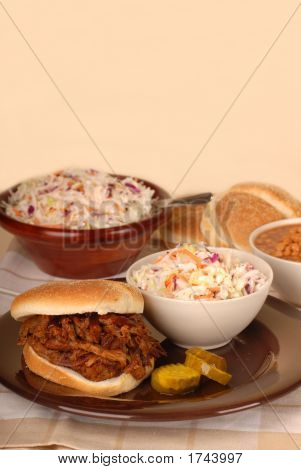 Pulled Pork Sandwich With Cole Slaw, Baked Beans And Pickles