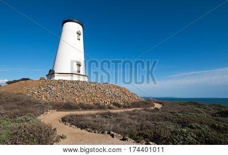 Pathway winding around Lighthouse at Piedras Blancas point on the Central California Coast north of San Simeon California USA