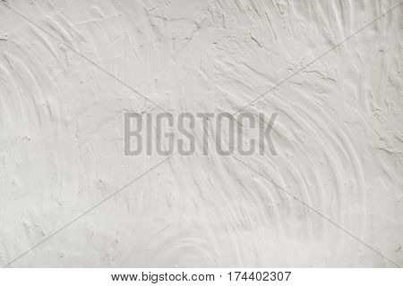 Rugged stucco white painted wall surface texture as background