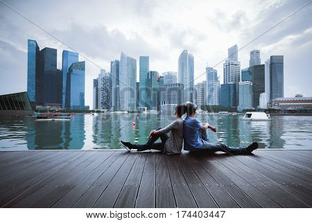 Couple sitting relax in the evening at Marina bay Singapore