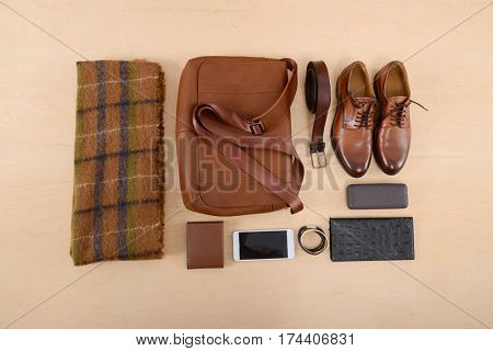 Set of clothes and various accessories for men on wooden table