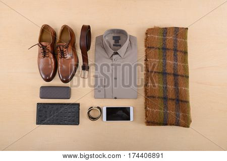Set of clothes and various accessories for men on wooden