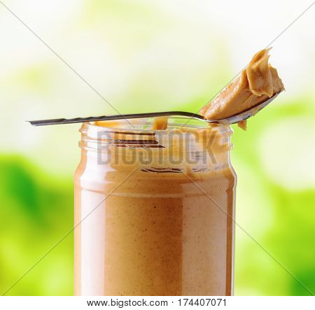 Jar Of Peanut Butter On Nature Background