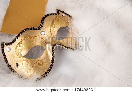 Carnival Mask And A Gold Card On White Boa. Theatre Day