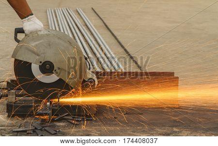 Worker cutting steel by cutting fiber in steel factory.