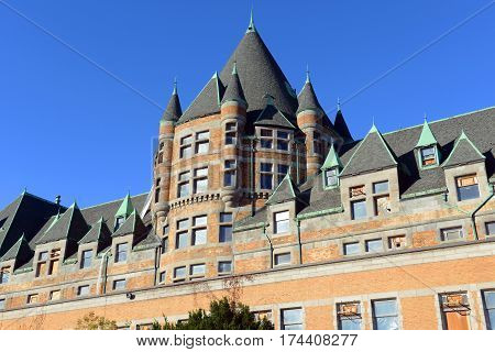 Place Viger was built in 1898 as a railway station with Château Style (Châteauesque). Now this building is a grand hotel in Old town Montreal, Quebec, Canada.