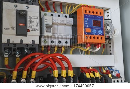 Close-up electrical wiring with timer and contactors.