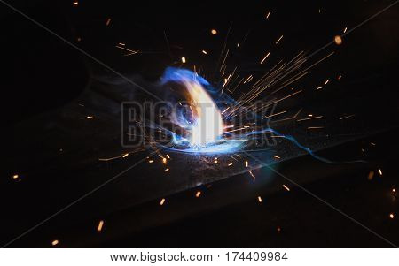 Arc welding and welding fumes at the factory welding closeup.