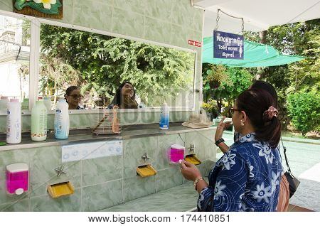Thai Woman And Old Women Cleaning And Makeup At Washstand In Public Toilet