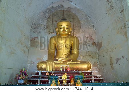 BAGAN, MYANMAR - DECEMBER 23, 2016: Antique sculpture of a seated Buddha in the ancient temple Gawdaw-palin
