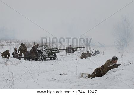 SAINT PETERSBURG, RUSSIA - JANUARY 15, 2017: Soviet artillery in position. Military-historical reconstruction of fights of the great Patriotic war for the lifting of the blockade of Leningrad