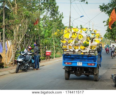 Carrying Flowers To The Market In Vietnam