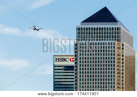 LONDON, UK - CIRCA 2015: An Aircraft Flying Over One Canada Square, Canary Wharf, London