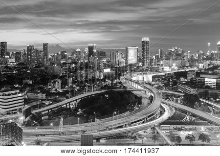 Black and White aerial view interchanged highway overpass with city downtown background