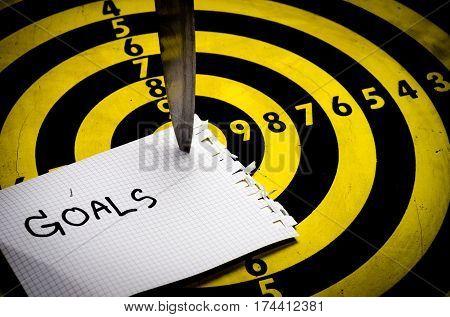 Cogent business ,knife on target dart board , copy space background