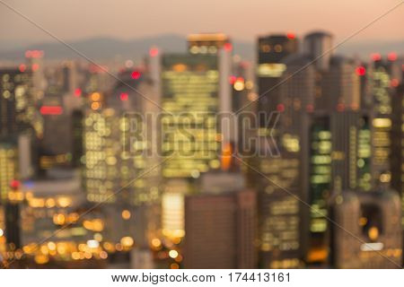 Blurred bokeh light city of Osaka at twilght abstract background