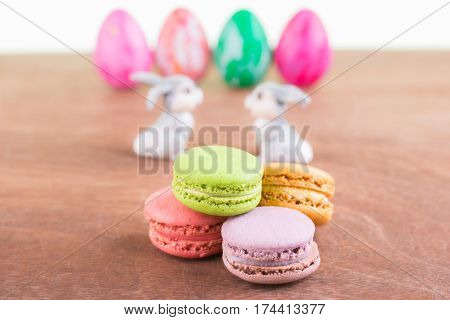 Macarons with Easter egg and bunnies close up