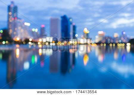 Twilight blured light office building with reflection abstract background