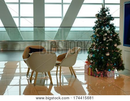 Living room at the international airport with Christmas decorations.