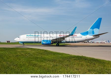 Moscow region, Vnukovo, Russia - July 02, 2016: Boeing 737 Pobeda Airlines standing at Vnukovo international airport