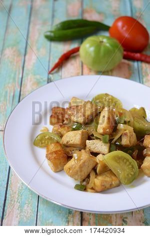 Stir fried tofu with green tomato and chili or Oseng Tahu, Indonesian food